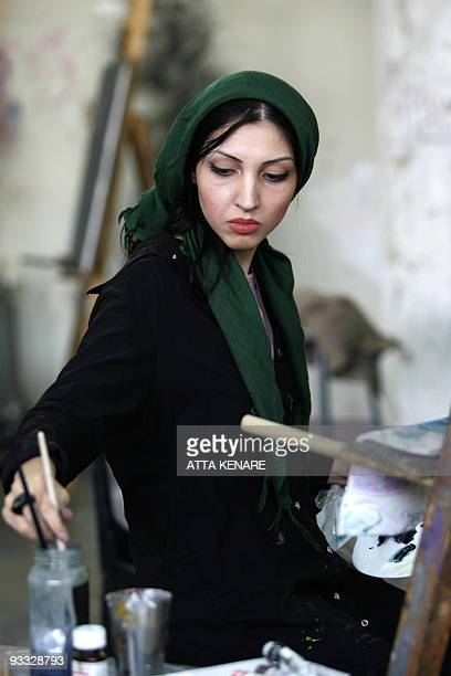 An Iranian female student paints in the Fine Arts Faculty of Tehran University in Tehran 29 October 2006 Women face many limitations in Iran but...
