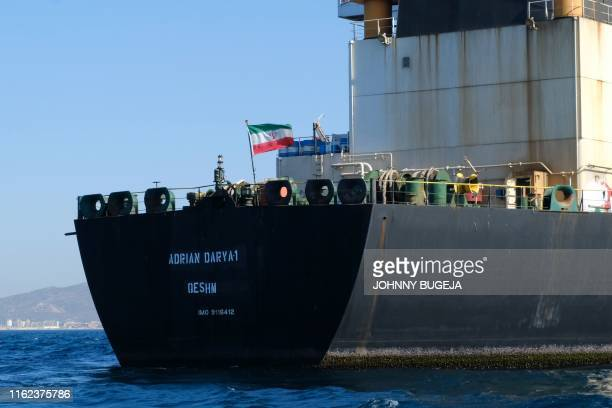 TOPSHOT An Iranian flag flutters on board the Adrian Darya oil tanker formerly known as Grace 1 off the coast of Gibraltar on August 18 2019...