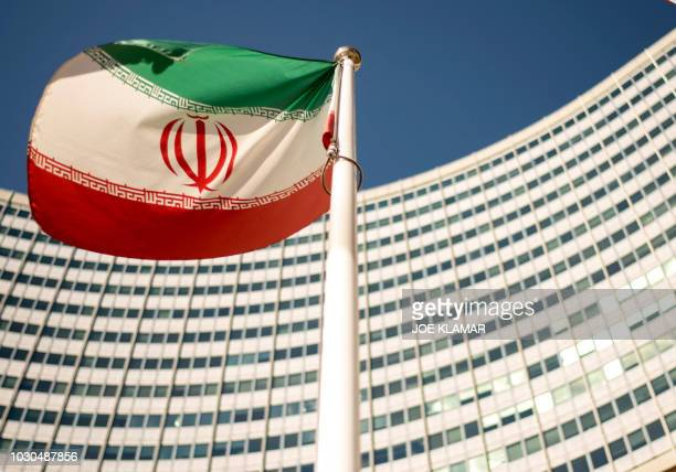 An Iranian flag flutters outside of the UN headquarters during the opening of the International Atomic Energy Agency Board of Governors meeting at...