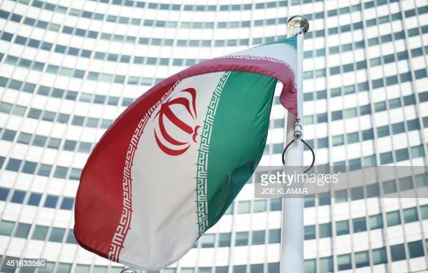 An Iranian flag waves in a wind outside the Vienna International Centre hosting the United Nations headquarters and the International Atomic Energy...