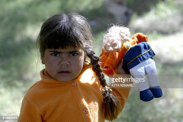 An Iranian girl poses for a picture 07 November 2004 in the southeastern devastated city of Bam where a powerful earthquake killed more than 26000...