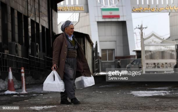 An Iranian Kurdish man arrives at the IranIraq border crossing of Haji Omran on January 3 one day after two border posts were reopened between Iraqi...