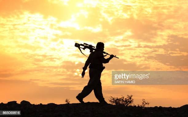 An Iranian Kurdish Peshmerga, member of the Iranian Kurdistan Democratic Party , takes part in routine military exercise in Koya, 100 kms east of...