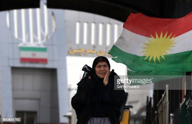 An Iranian Kurdish woman arrives at the IranIraq border crossing of Haji Omran on January 3 one day after two border posts were reopened between...