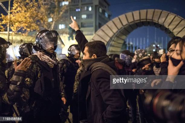 An Iranian man confronts riot police during a demonstration outside Tehran's Amir Kabir University on January 11 2020 Demonstrations broke out for a...