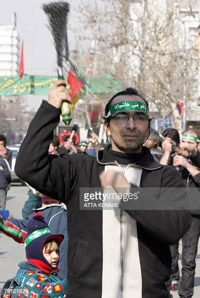 An Iranian man flagellates himself with chains to commemorate the martyrdom of Imam alHussein in Tehran 18 January 2008 The rituals of Ashura...