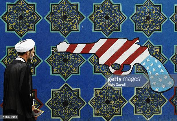 An Iranian man passes an antiUS mural outside the former US Embassy at a gathering to mark the 25th anniversary of the seizure of the US Embassy on...