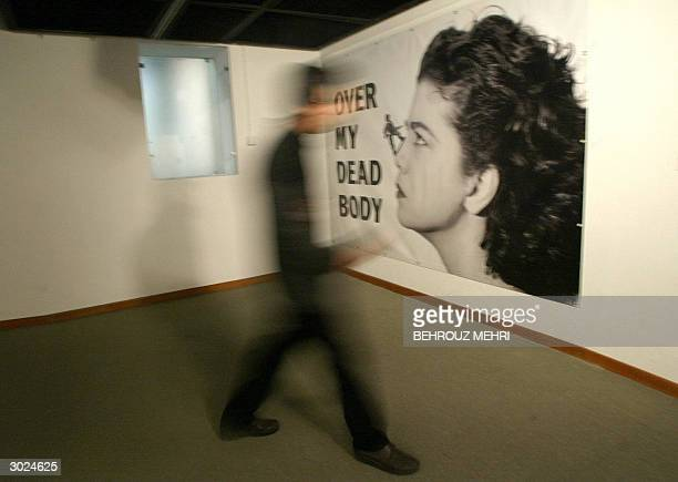 An Iranian man passes by the 'Over my dead body' computergenerated work by British artist Mona Hatoum at the 20th Century British Sculpture...