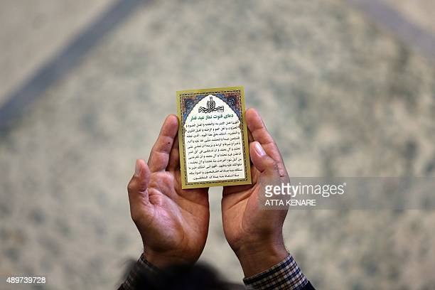 An Iranian man performs Eid alAdha prayers at Tehran University on September 24 2015 Eid alAdha is celebrated throughout the Muslim world as a...