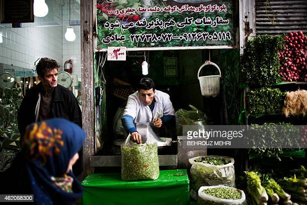 An Iranian man prepares some chopped mixed vegetables for Iranian dish recipes at Tajrish bazaar in northern Tehran on January 24 2015 AFP...