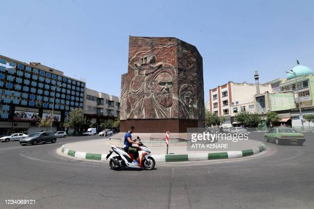 An Iranian man rides a motorbike at Enghelab square in the centre of the capital Tehran, on July 20 as authorities tighten restrictions amid the...