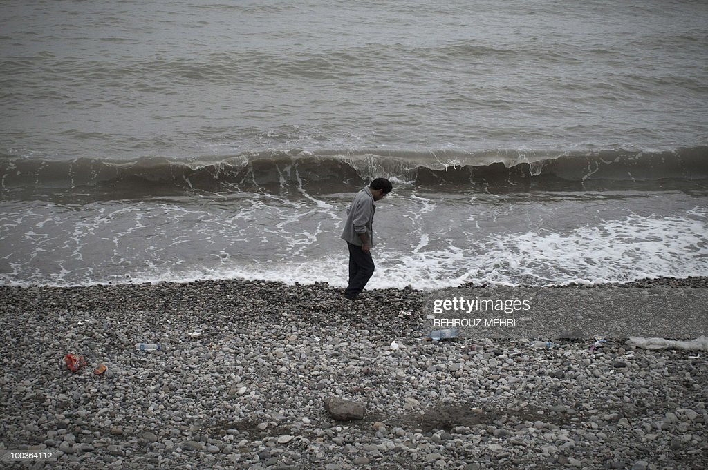 An Iranian man walks along the Caspian sea in the coastal city of Tonekabon, 250 kms north of the capital Tehran, on May 21, 2010. The Caspian Sea is the world's largest lake with a surface area of 371,000 kms bounded by northern Iran, southern Russia, western Kazakhstan and Turkmenistan, and eastern Azerbaijan. Iran was preparing to notify the International Atomic Energy Agency later on May 24 of a nuclear fuel swap deal brokered by Turkey and Brazil, the spokesman of Iran's Atomic Energy Organisation said.