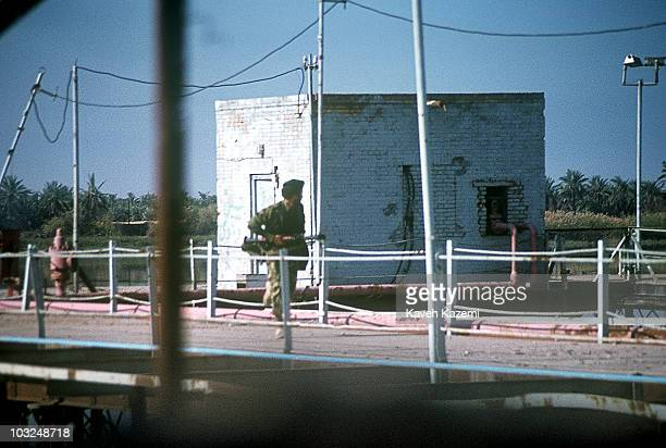 An Iranian marine returns after firing an RPG7 rocket into an Iraqi position across Arvand Rud also known as ShattalArab in Abadan Iran 1981