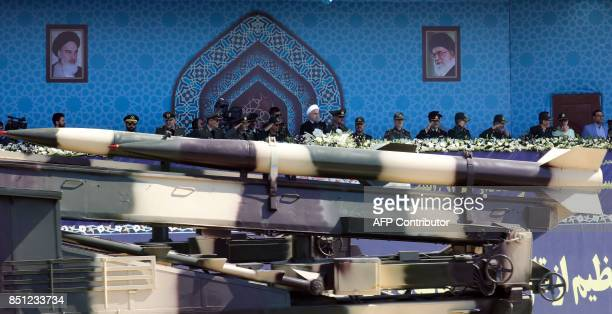 An Iranian medium range missile Zelzal passes by Iranian President Hassan Rouhani during the annual military parade marking the anniversary of the...