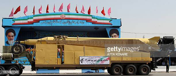 An Iranian military truck carries a longrange GhadrF ballistic missile during an annual military parade which marks Iran's eightyear war with Iraq in...