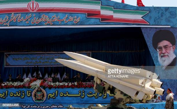 An Iranian military truck carries a US made Hawk air defence missile system from the Shah era during a parade on the occasion of the country's Army...