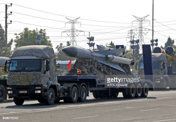 An Iranian military truck carries missiles during a parade on the occasion of the country's annual army day on April 18 2018 in Tehran President...