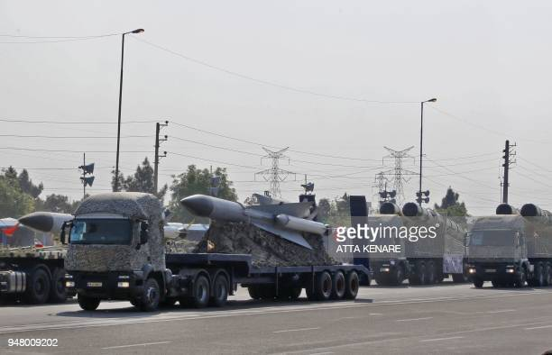 An Iranian military truck carries part of surfacetoair missiles during a parade on the occasion of the country's annual army day on April 18 in...