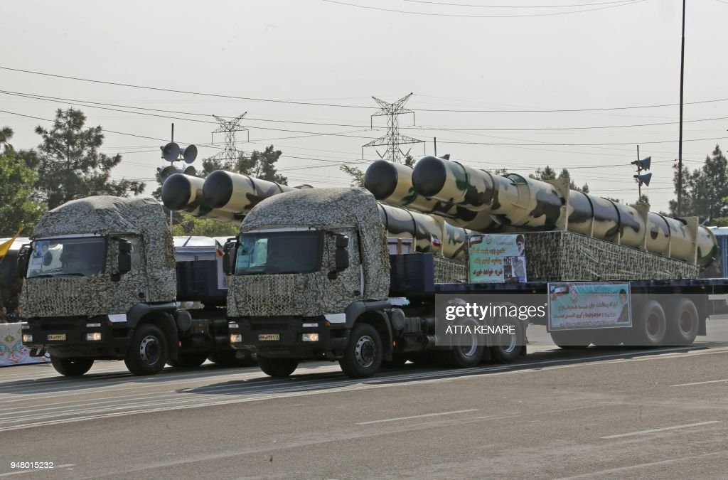 An Iranian military truck carries parts of a S-200 air
