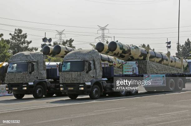 An Iranian military truck carries parts of a S200 air defence missile system during a parade on the occasion of the country's annual army day on...