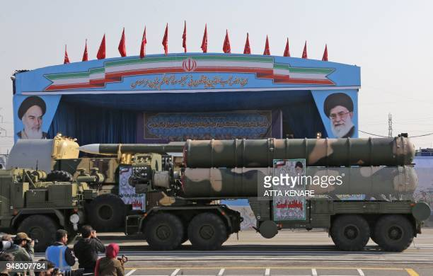 An Iranian military truck carries parts of a S300 air defence missile system during a parade on the occasion of the country's annual army day on...