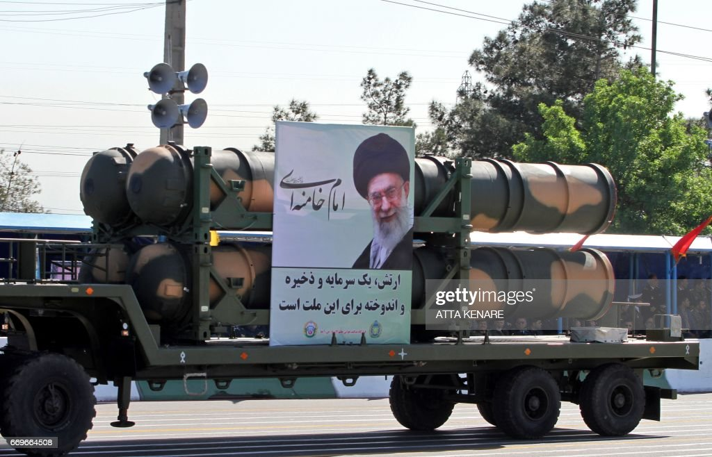 An Iranian military truck carries parts of the S-300 air