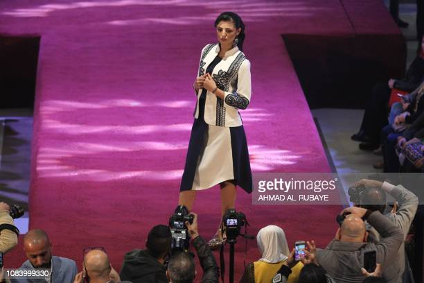 An Iranian model presents a creation by an Iranian female fashion designer during a show at a shopping mall in the Iraqi capital Baghdad on January...