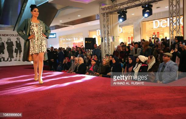 An Iranian model presents a creation by one of two Iranian female fashion designers during a show at a shopping mall in the Iraqi capital Baghdad on...