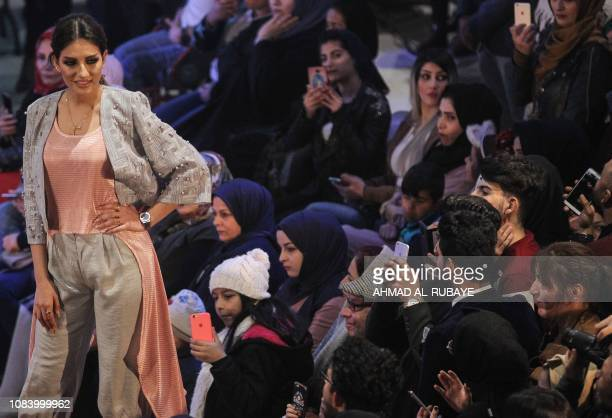 An Iranian model presents a creation by two Iranian female fashion designers during a show at a shopping mall in the Iraqi capital Baghdad on January...