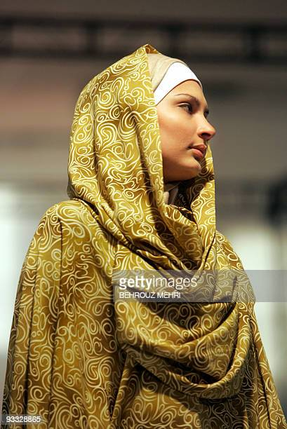 An Iranian model presents a traditional Islamic dress during a fashion show in Tehran 18 January 2007 The twoday event was organized by Iranian...