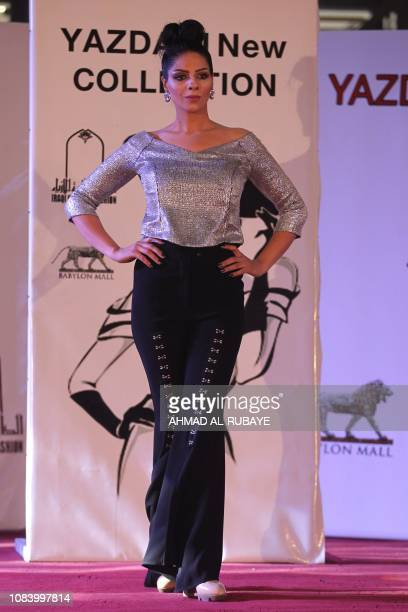 An Iranian model presents an outfit designed by an Iranian female fashion designer during a show at a shopping mall in the Iraqi capital Baghdad on...