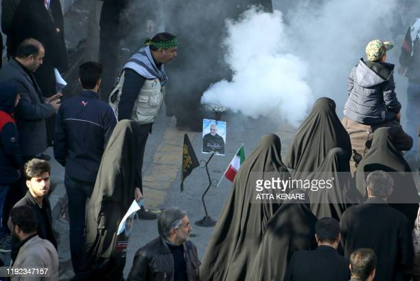 An Iranian mourner burns incense during the final stage of funeral processions for slain top general Qasem Soleimani in his hometown Kerman on...