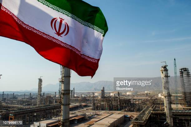 An Iranian national flag flies above the new Phase 3 facility at the Persian Gulf Star Co gas condensate refinery in Bandar Abbas Iran on Wednesday...