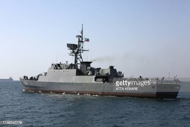 "An Iranian Navy warship takes part in the ""National Persian Gulf day"" in the Strait of Hormuz, on April 30, 2019. - The date coincides with the..."