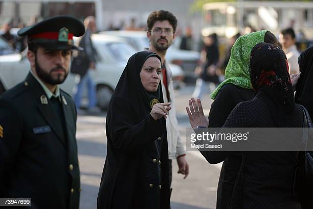 An Iranian policewoman warns a young woman about her clothing and hair during a crackdown to enforce Islamic dress code on April 22 2007 in Tehran...