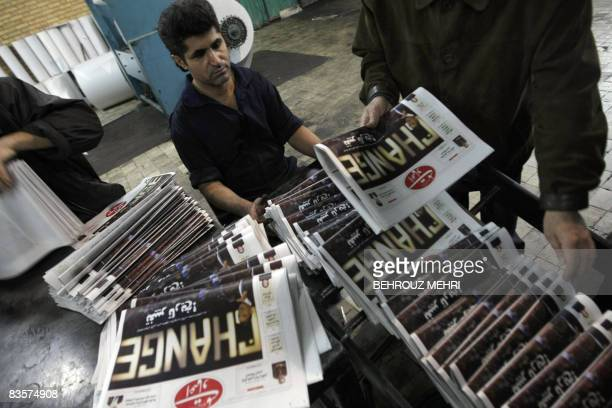 An Iranian printing technician checks printed copies of Iranian reformist daily Etemade Melli with a picture of US Presidentelect Barack Obama on the...