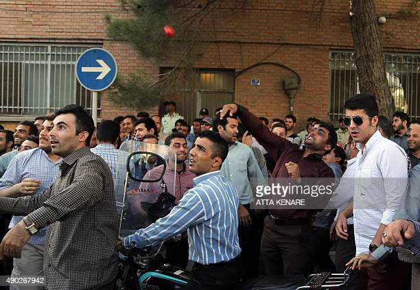 An Iranian protester throws a tomatoe during a demonstration against Saudi Arabia outside its embassy in Tehran on September 27 four days after some...