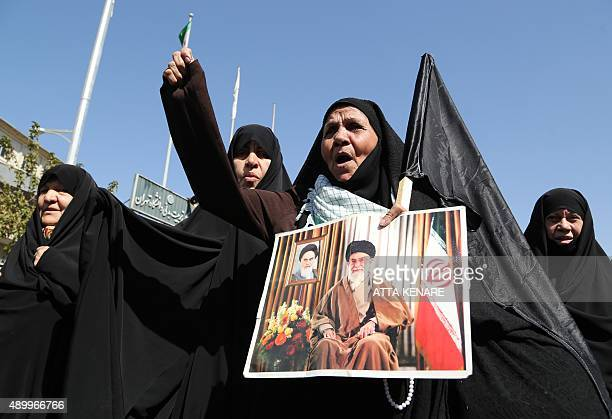 An Iranian protestor holds a picture of Iran's supreme leader Ayatollah Ali Khamenei during a demonstration against Saudi Arabia after 131 Iranian...