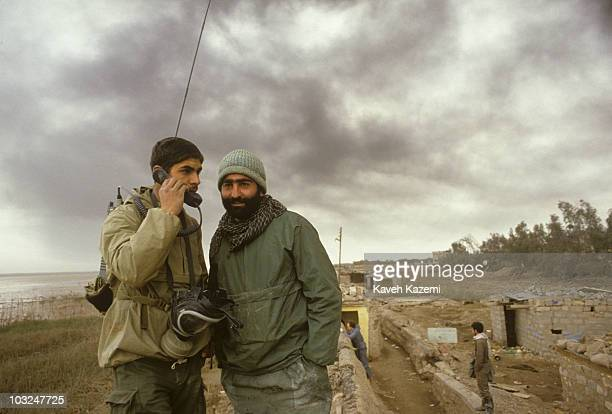 An Iranian Revolutionary Guard carrying a radio talks to the command, in anticipation of chemical raids by Iraqi planes in Al-Fao Peninsula, Iraq,...
