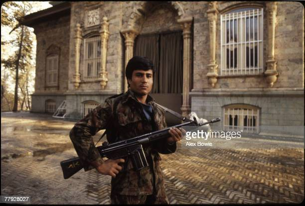 An Iranian Revolutionary Guard outside the Green Palace in the Niavaran Palace complex the former home of exiled Shah of Iran Mohammad Reza Pahlevi...