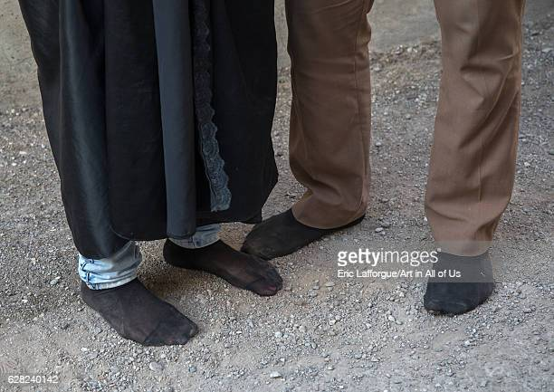 An iranian shiite couple walks in stocking feet during the Chehel Manbar ceremony a day before Ashura Lorestan Province Khorramabad Iran on October...