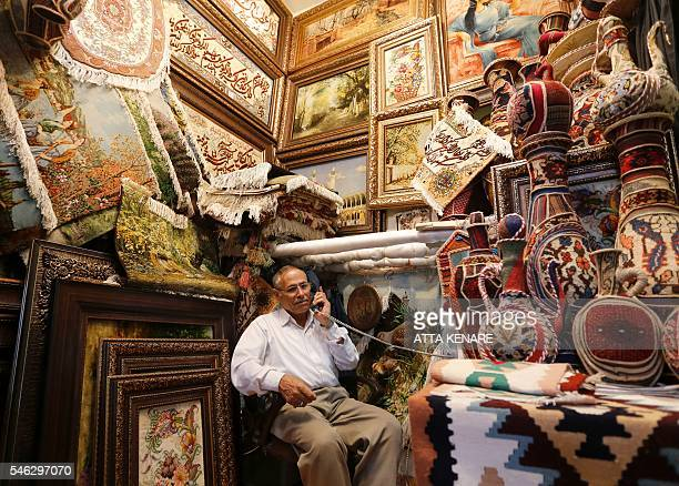 An Iranian shopkeeper waits for customers in Tehran's ancient Grand Bazaar on July 11 2016 A year ago a landmark nuclear deal with world powers led...