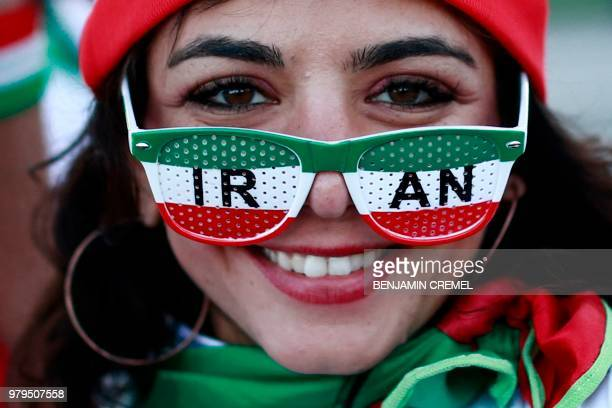 TOPSHOT An Iranian supporter is seen outside the stadium ahead of the Russia 2018 World Cup Group B football match between Iran and Spain at the...