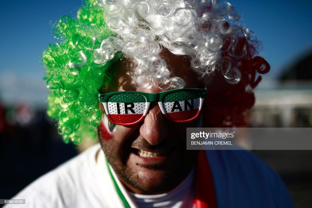 TOPSHOT - An Iranian supporter poses for a picture ahead of the Russia 2018 World Cup Group B football match between Iran and Spain at the Kazan Arena in Kazan on June 20, 2018. (Photo by Benjamin CREMEL / AFP) / RESTRICTED