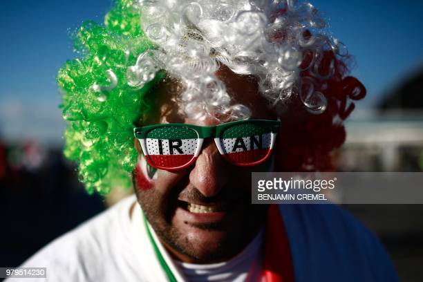 TOPSHOT An Iranian supporter poses for a picture ahead of the Russia 2018 World Cup Group B football match between Iran and Spain at the Kazan Arena...