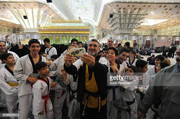 An Iranian Taekwondo club as a selfportrait with the shrine in the background as Iranian officials and security forces mark the 37th anniversary of...