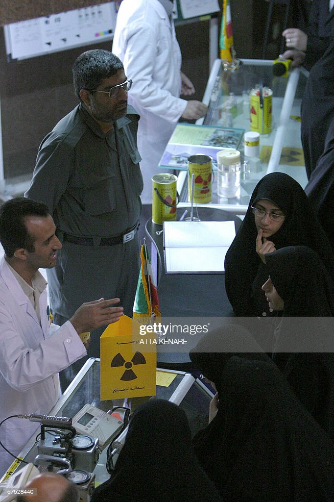 An Iranian technician explains about an equipment to conservative women during an exhibition of Iran's Atomic Energy Organization at the an university in the city of Qom, 130 kms south of the capital Tehran, 04 May 2006. Iran claimed today it had made more progress in ultra-sensitive nuclear work, showing yet more defiance in the face of Western lobbying for tough Security Council action.