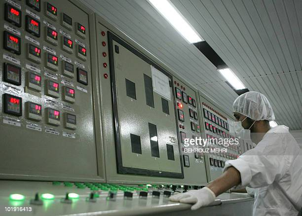 An Iranian technician works at the control room of the Isfahan Uranium Conversion Facilities , 420 kms south of Tehran, 03 February 2007. Iran opened...