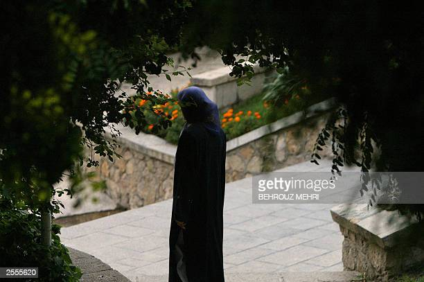 An Iranian veiled woman walks in a park in Tehran, 02 October 2003. Iranian officials and inspectors from the International Atomic Energy Agency...