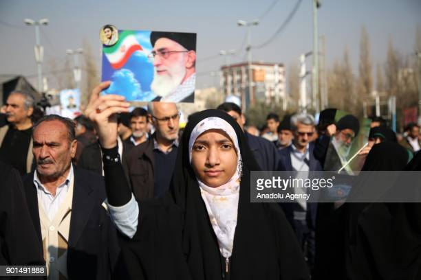An Iranian woman attends a protest after performing the Friday Prayer at Imam Khomeini Mosque following US' statement about backing the...